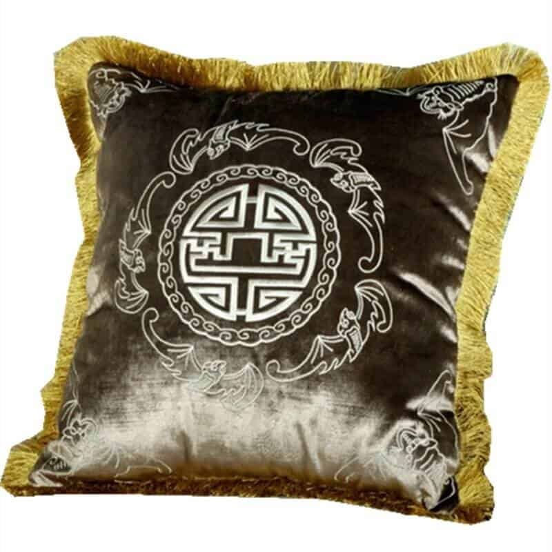 Cushion covers with gold tassels